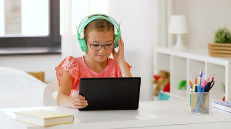 playlist : girl in headphones with tablet computer at home Stock Footage