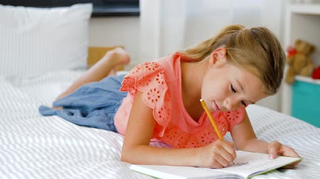 taslakkitabım : little girl drawing in sketchbook at home