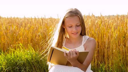 taslakkitabım : smiling girl writing to diary on cereal field