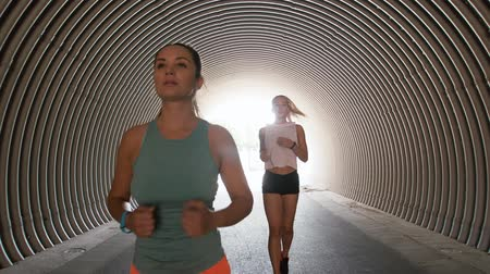 juntos : young women or female friends running outdoors Stock Footage