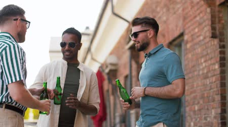 south asian food : happy male friends drinking beer at rooftop party Stock Footage