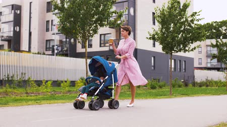 навынос : mother with baby in stroller and coffee in city