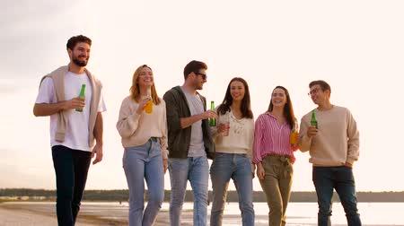 cidra : friends with non alcoholic drinks walking on beach