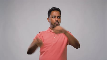 maglietta polo : indian man making faces and different gestures