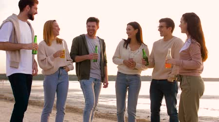 cidra : friends with non alcoholic drinks talking on beach