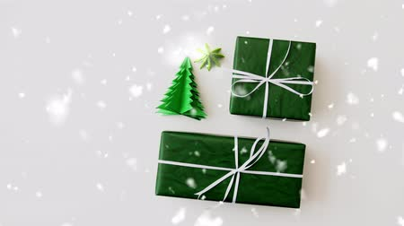 kokarda : snowing over gift boxes and christmas tree origami