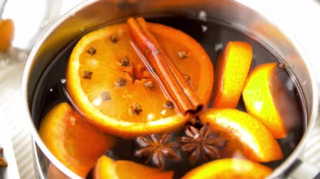 anis : spices and hot mulled wine with orange slices