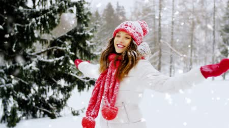 knitted : happy young woman in winter forest Stock Footage