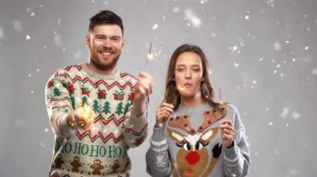 knitted : happy couple with sparklers at christmas party