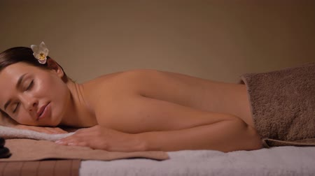 orchidea : young woman lying at spa or massage parlor