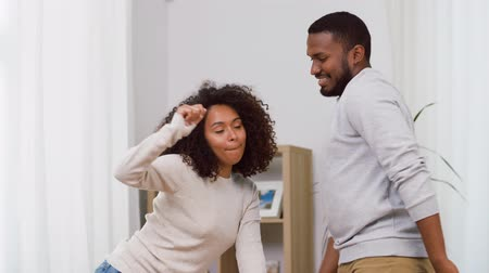 taniec : happy african american couple dancing at home