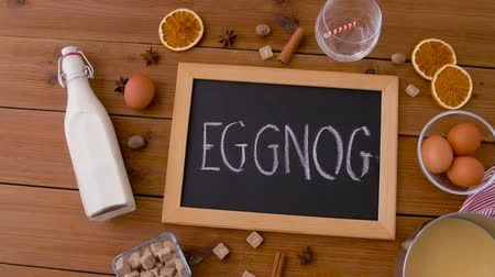 x mas : eggnog word on chalkboard, ingredients and spices