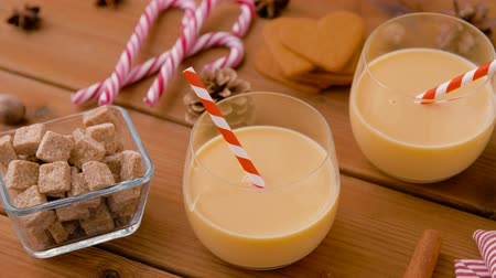 anis : glasses of eggnog, ingredients and spices on wood