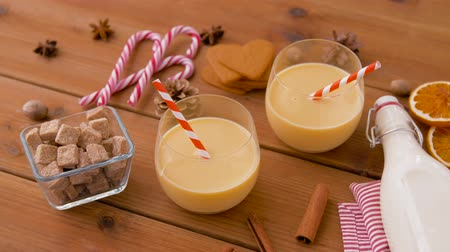 anason : glasses of eggnog, ingredients and spices on wood