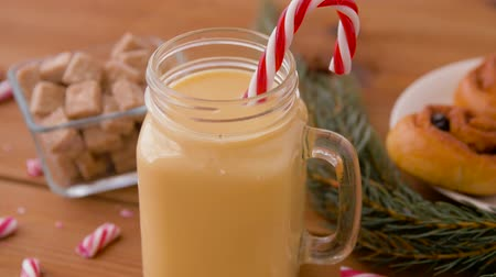anijs : glass mug of eggnog, ingredients and sweets