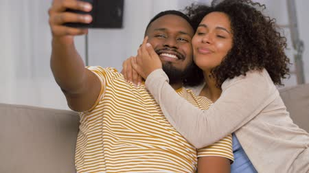 picture box : happy couple moving to new home and taking selfie Stock Footage