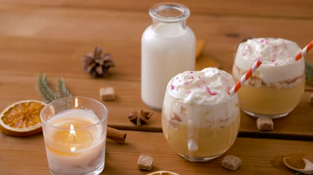 açoitado : glasses of eggnog, ingredients and spices on wood