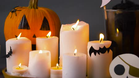 scull : pumpkins, candles and halloween decorations