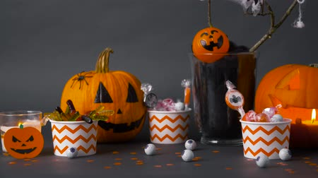 scull : pumpkins, candies and halloween decorations