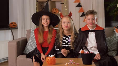 scull : kids in halloween costumes having fun at home Stock Footage
