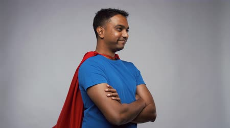 ukłon : happy smiling indian man in red superhero cape