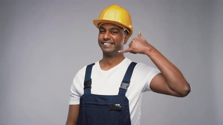 overall : happy worker or builder making phone call gesture Stock Footage