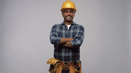 клетчатый : happy indian worker or builder with crossed arms Стоковые видеозаписи