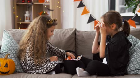 fruit bat : girls in halloween costumes with candies at home