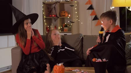 witch hat : kids in halloween costumes playing at home Stock Footage
