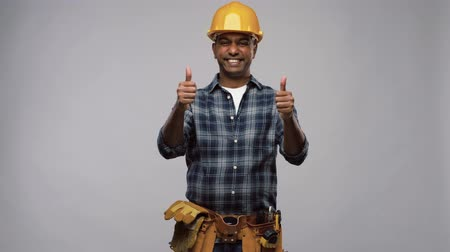 便利屋 : happy indian worker or builder showing thumbs up