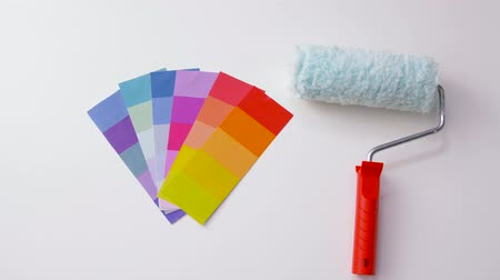 color swatch : paint roller and color palette on white background Stock Footage