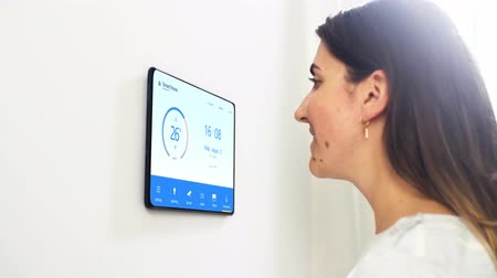 distante : woman looking at tablet computer at smart home