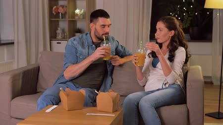sallama : happy couple drinking takeaway juice at home