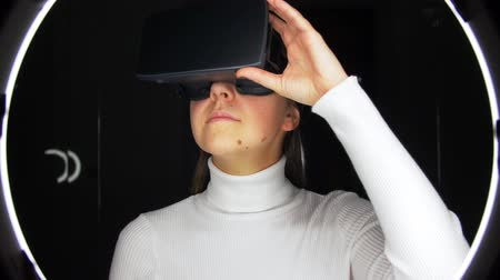 futurismo : woman in virtual reality headset or vr glasses