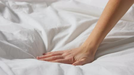 sprzątanie : hand of woman touching bed covered with blanket