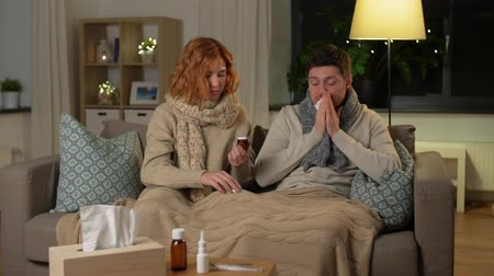 epidemy : sick young couple at home in evening Stock Footage