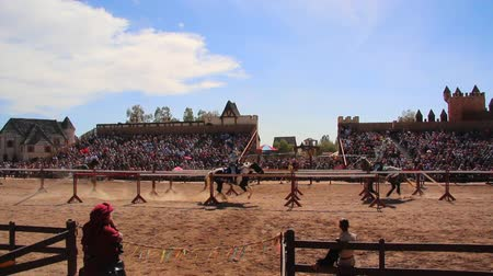 rytíř : Wide Shot of Two Armored Knights on Horseback Colliding During a Jousting Tournament