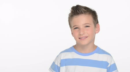 posando : Cute boy  of ten years  looking in camera and smiling  - at studio Stock Footage