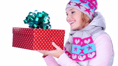 başörtüsü : Happy smiling woman with new year gift in hands,  in a winter clothes posing at studio