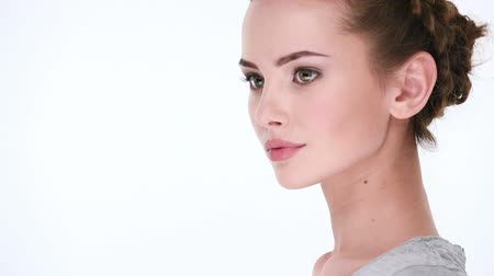 perfil : Peaceful beautiful woman without emotion looks away Stock Footage