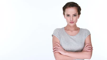 рука : Upset serious woman with crossed arms  posing at camera Стоковые видеозаписи
