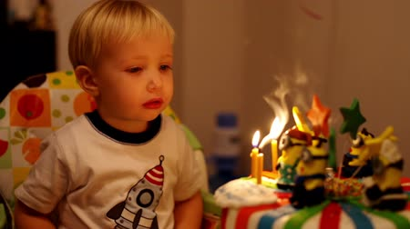dilek : adorable three year old boy celebrating his birthday and blowing candles
