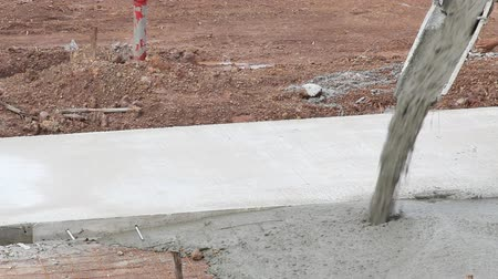 beton : Pouring cement during Upgrade to residential streetStock Footage Clip
