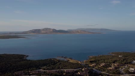 vnitrozemí : Aerial of a pretty village in Sardinia, Italy. Sunrise on the coast, mountains in the background Dostupné videozáznamy