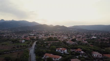szmaragd : Aerial of a pretty village in Sardinia, Italy. Sunset, mountains in the background