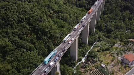 suspension : Aerial Italy. A big long bridge in a mountain valley. A lot of bike buses cost