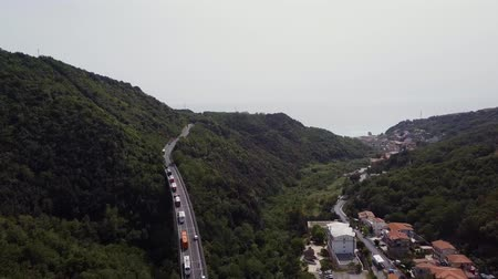 маргарита : Aerial Italy. A big long bridge in a mountain valley. A lot of bike buses cost