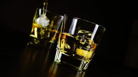 nightcap : pouring whiskey on bar table lounge bar atmosphere