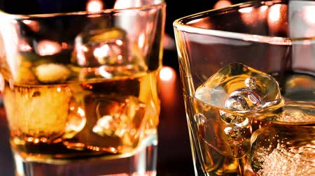 nightcap : barman pouring whiskey on bar table, whisky relax time concept Stock Footage