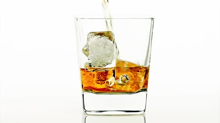 viski : barman pouring whiskey on white background, whisky relax time concept Stok Video